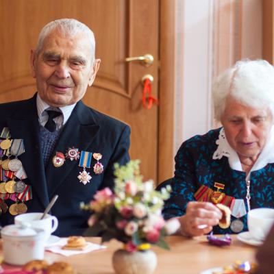 Male Veteran with Tinnitus having a Meal with His Wife
