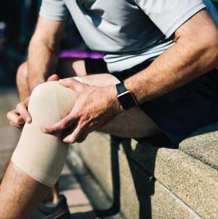 Man with Arthritis Holding His Knee