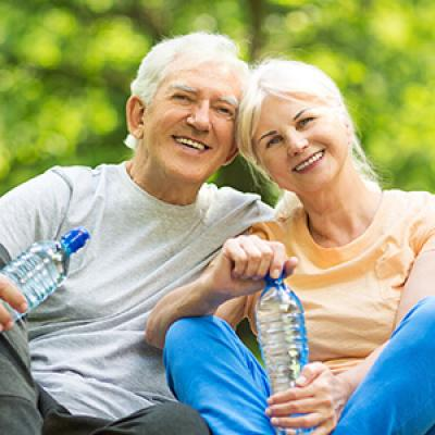 Elderly couple resting after exercise