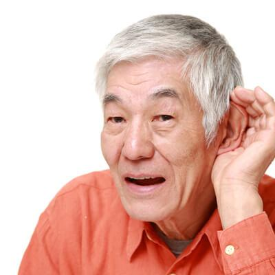 man attempting to hear better with hearing loss