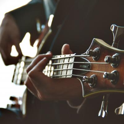 Musician with Hearing Loss Holding His Bass Guitar