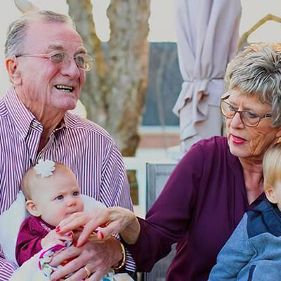 Two grandparents with hearing aids
