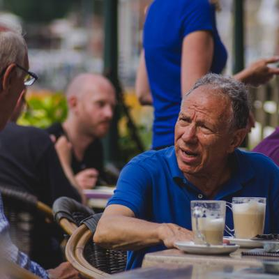 Two Older Men Having a Conversation Over Coffee