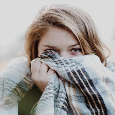 Girl Protecting Her Hearing from the Cold Weather with a Scarf