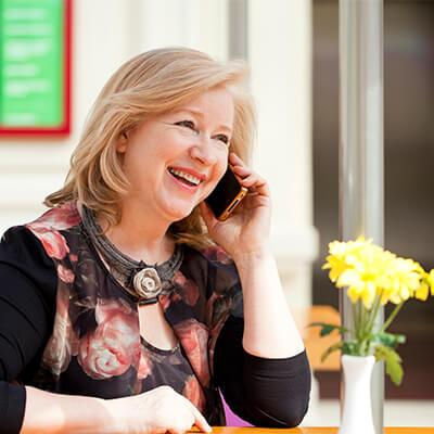 woman buying hearing aids over the phone