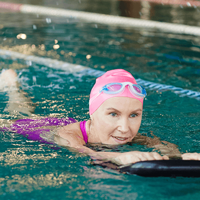 woman protecting hearing aids from moisture while swimming