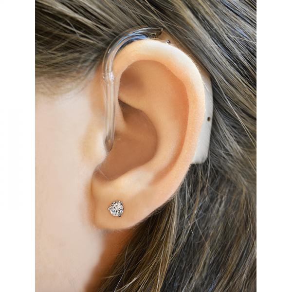 Refurbished HearClear HC64 Digital Hearing Aid on the ear