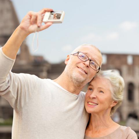 Mature couple traveling with hearing loss