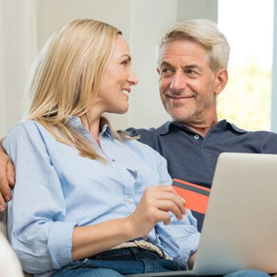 happy couple buying hearing aids online