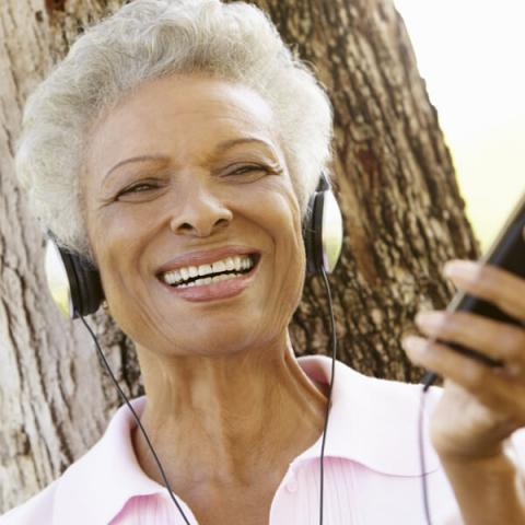 Woman suffering the negative effects of technology on hearing