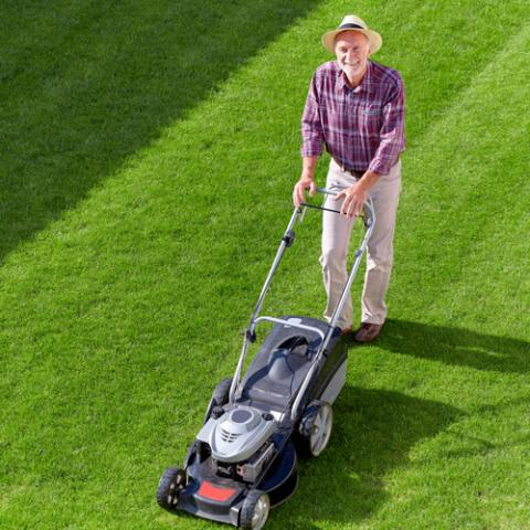 man using lawnmower, a summer hearing hazard